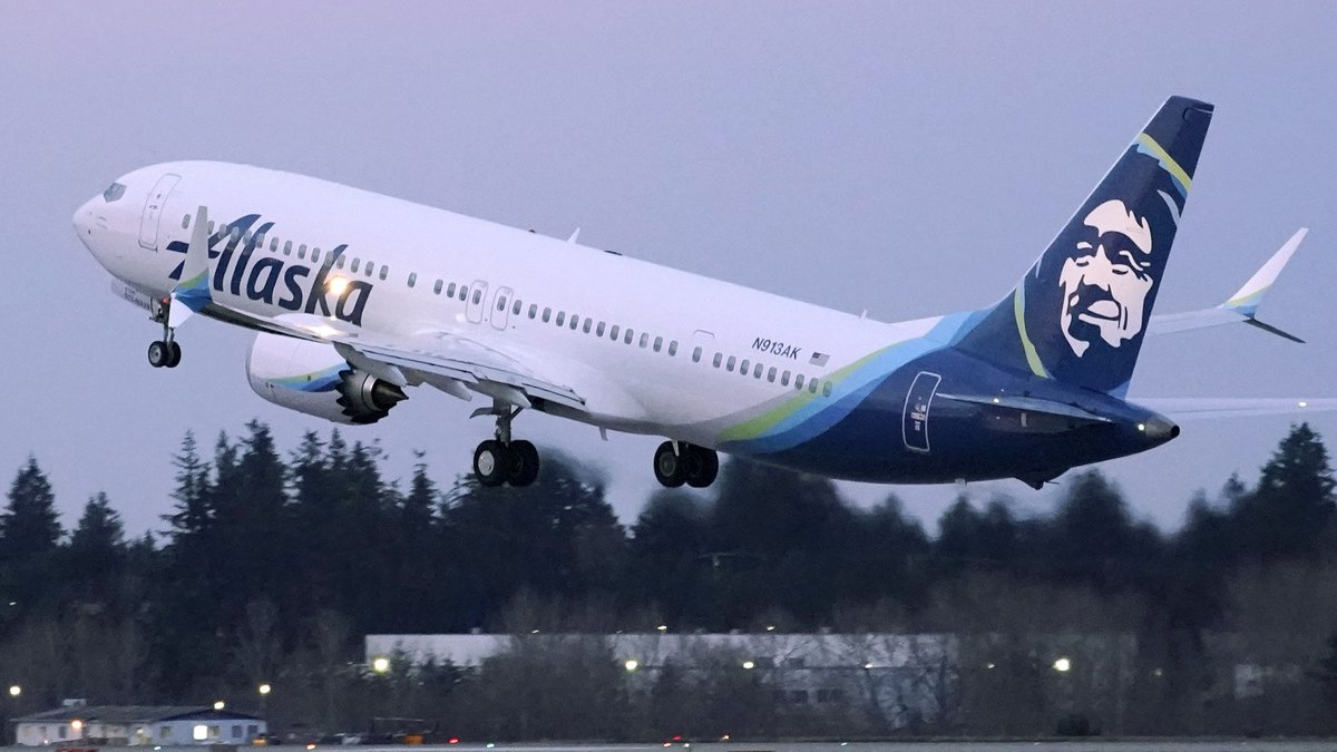 FILE - The first Alaska Airlines passenger flight on a Boeing 737-9 Max airplane takes off,...