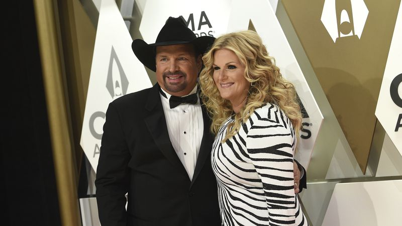 Garth Brooks, left, and Trisha Yearwood arrive at the 53rd annual CMA Awards at Bridgestone...