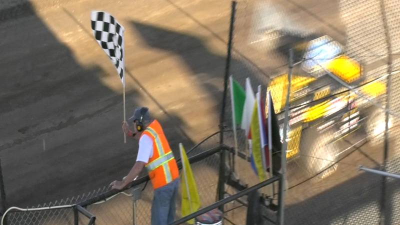Sprint drivers cross the finish line at opening night at the Mitchell Raceway.