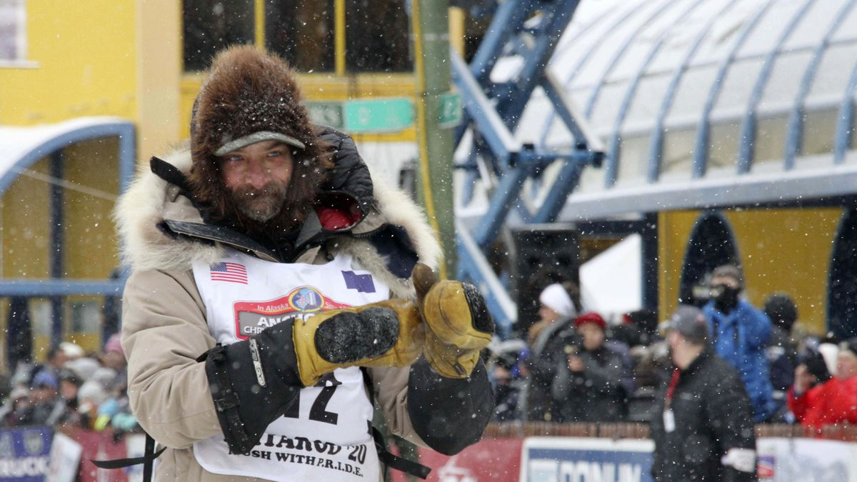 FILE - In this March 7, 2020 file photo, four-time Iditarod Trail Sled Dog Race champion Lance Mackey is shown before the ceremonial start of the Iditarod Trail Sled Dog Race in Anchorage, Alaska.  (AP Photo/Mark Thiessen, File)