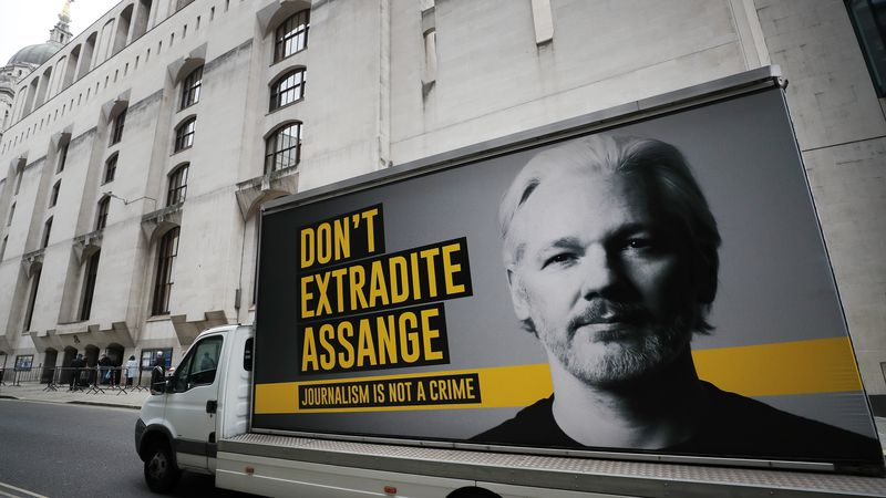 A truck with a billboard of Julian Assange arrives at the Old Bailey court in London, Monday,...