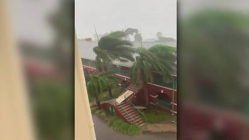 Hurricane Elsa is bringing heavy rain and wind to the Caribbean, as seen here in Barbados on...