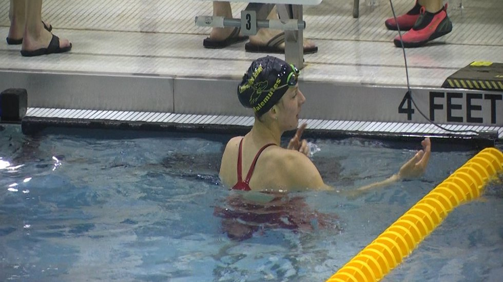 Katy McCarter during a 2018 Region VI swim meet.