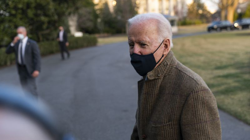 President Joe Biden speaks to the gathered media members upon arrival at the White House in...