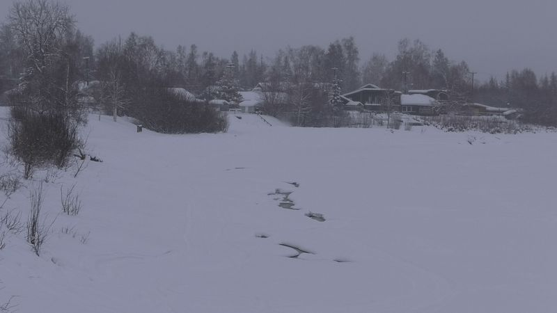 Open patches of water are seen on the Chena River. Officials are warning people to stay off of...