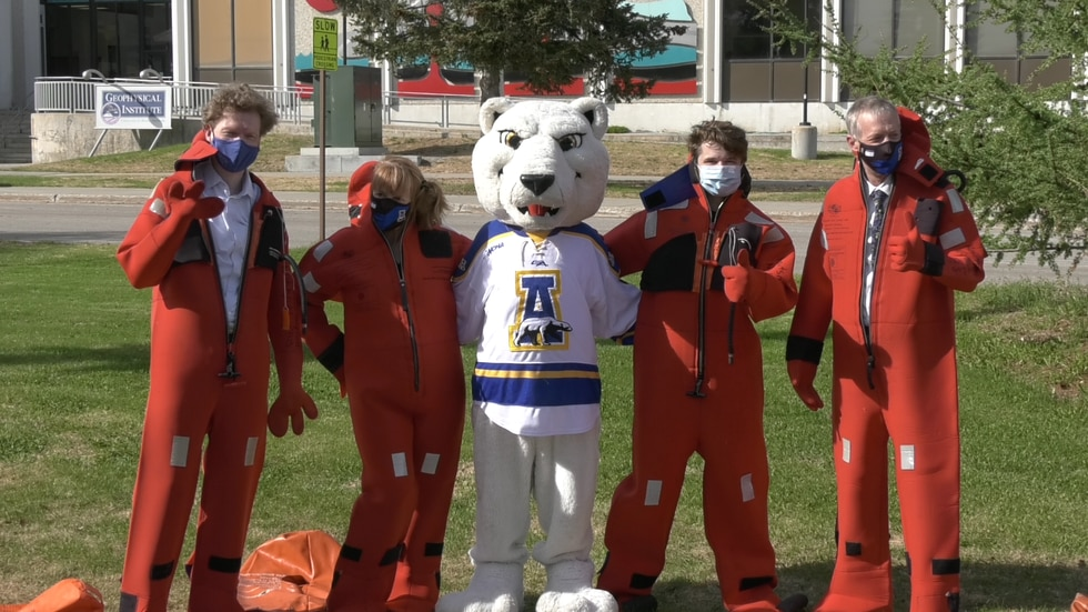 In the annual Arctic Survival suit challenge four competitors attempted to don full body...