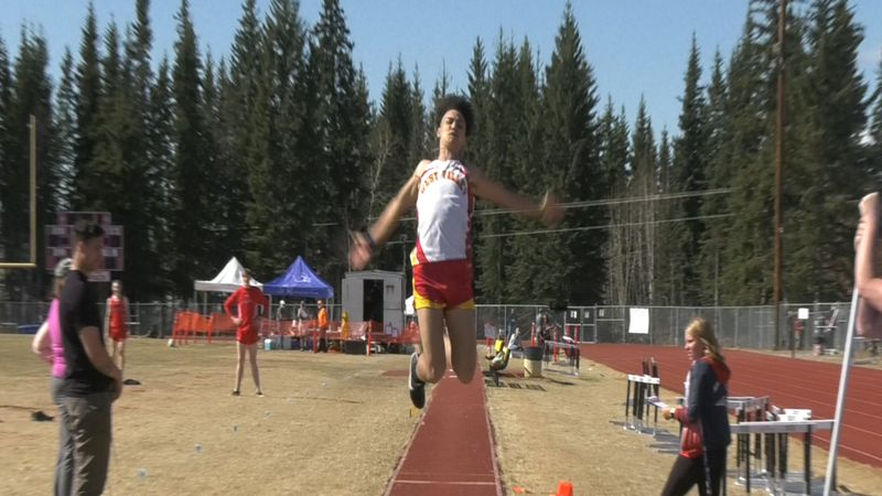 West Valley's Dan Glass leaps his way to a meet-best 17-06.5 score in the long jump Saturday.