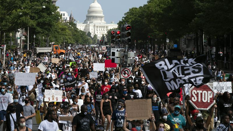 People walk on Pennsylvania Avenue during the March on Washington, Friday Aug. 28, 2020, on the...