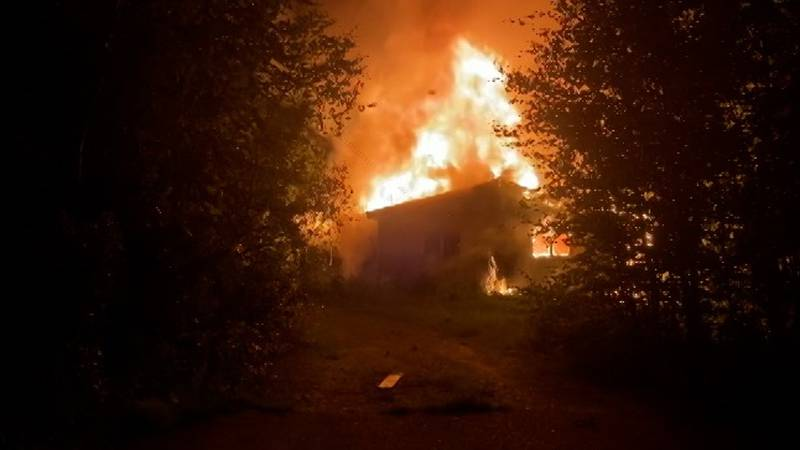 An unoccupied home burns on Chena Hot Springs Road in what is suspected to be another fire...