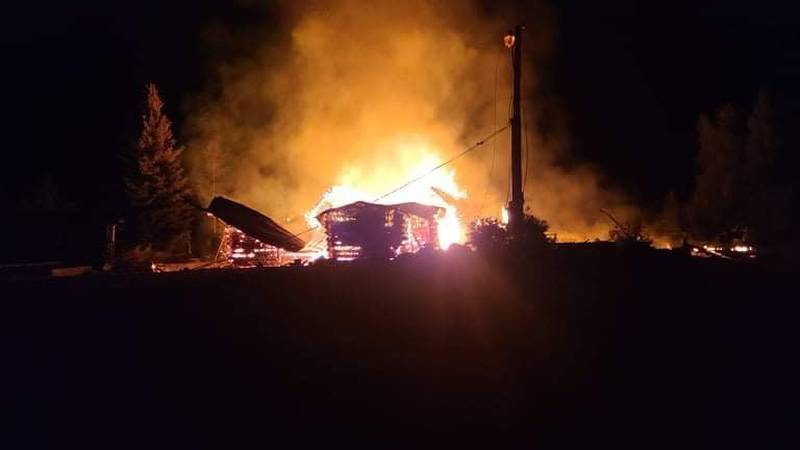 The Two Rivers Lodge is engulfed in flames early Monday Morning.