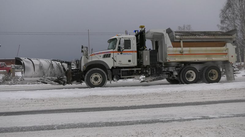 DOT is working to dig out Fairbanks roads after a record breaking storm dumped around 14 inches...