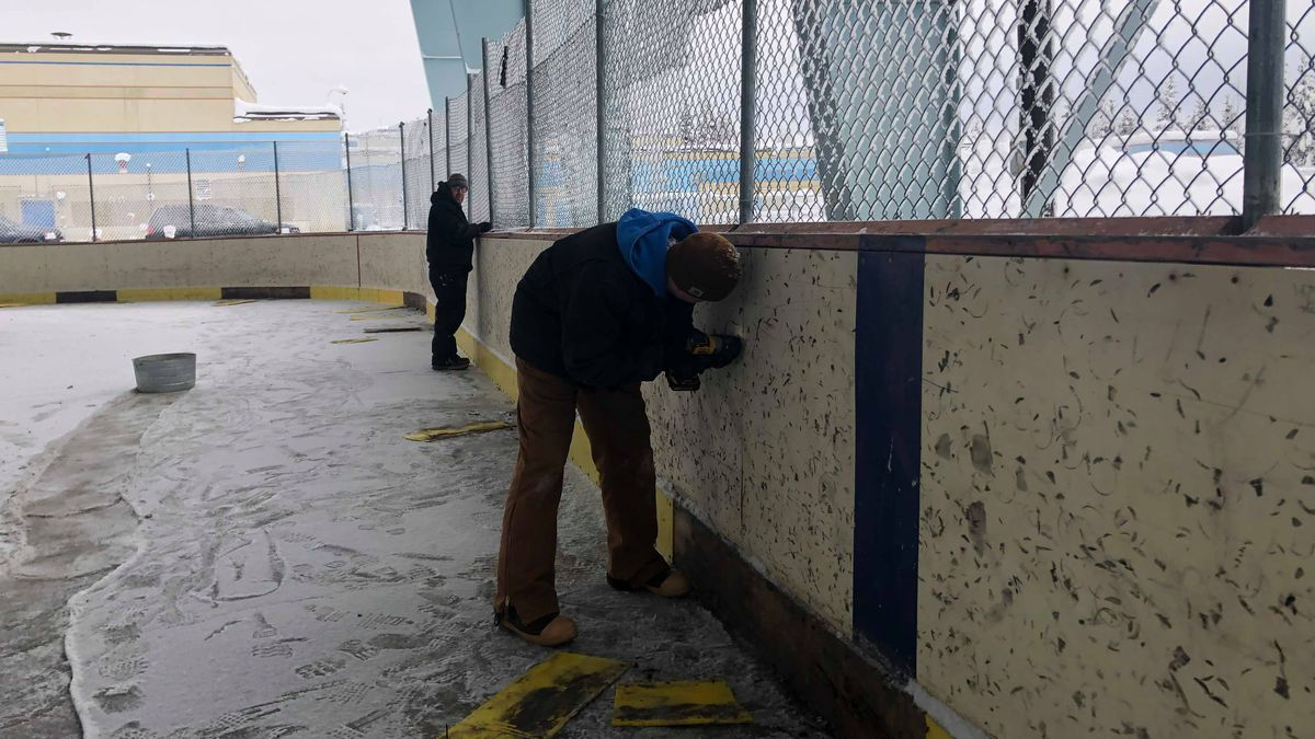 Volunteers from the Central Labor Council worked on the North Pole High School ice rink on Saturday to make it safe to skate on again. (Sara Tewksbury/KTVF)