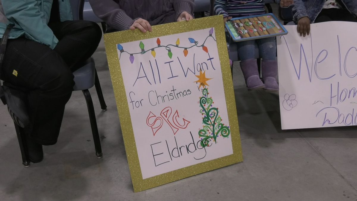 Families anxiously awaited their loved ones returning home with homemade signs. (Sara Tewksbury/KTVF)
