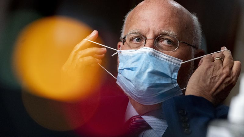 Centers for Disease Control and Prevention Director Dr. Robert Redfield puts his mask back on...