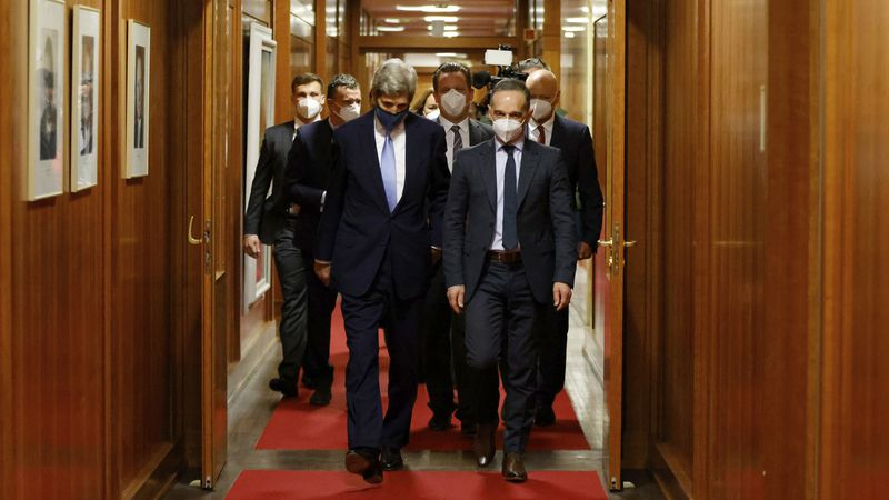 German Foreign Minister Heiko Maas, right, and U.S. special envoy for climate John Kerry, left,...